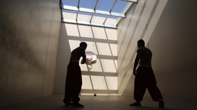 long shot detainees playing a ball game the facility the largest and newest immigration and customs enforcement detention center in california houses... - detainee stock videos and b-roll footage