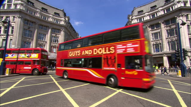 long shot double-decker buses and traffic crossing oxford circus / london - bus stock videos & royalty-free footage