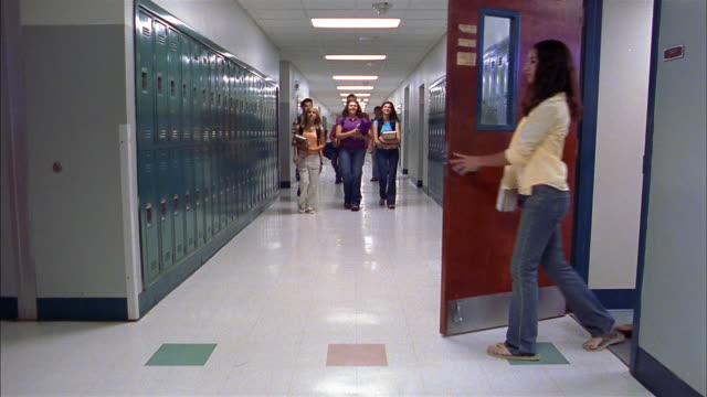 Long shot empty hallway / students walking from classrooms into hallway and talking / entering classrooms