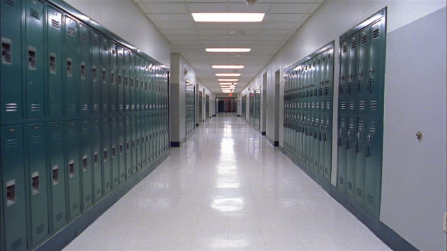 Long shot empty school hallway