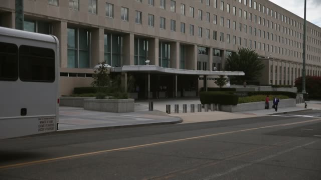 long shot, entrance to the u.s. department of state. . - federal building stock videos & royalty-free footage