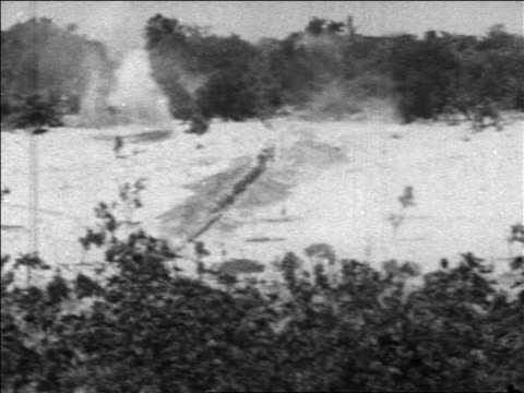 shaky long shot explosion in desert in six day war / newsreel - 第三次中東戦争点の映像素材/bロール