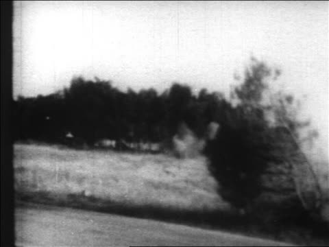 vidéos et rushes de b/w 1967 long shot explosion in front of trees in forest in six day war / newsreel - guerre des 6 jours