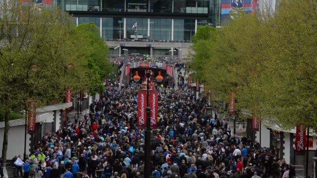 long shot, fans arriving at wembley stadium. manchester city v wigan athletic - fa cup final at wembley stadium on may 11, 2013 in london, england - wembley stadium stock videos & royalty-free footage