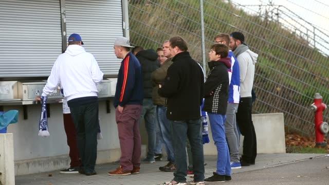 long shot, fans wait in front of cash boxes prior to to the bundesliga match between tsg 1899 hoffenheim and hertha bsc berlin at wirsol rhein-neckar... - 1899 bildbanksvideor och videomaterial från bakom kulisserna
