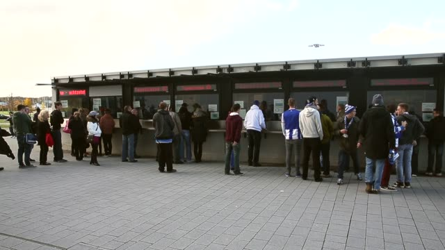 long shot, fans wait in front of cash boxes prior to to the bundesliga match between tsg 1899 hoffenheim and hertha bsc berlin at wirsol rhein-neckar... - 1899 stock videos & royalty-free footage