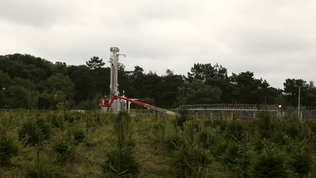 long shot, fracking site. protesters gather outside a drill site operated by cuadrilla resources ltd on august 19, 2013 in balcombe, west sussex.... - west sussex stock videos & royalty-free footage