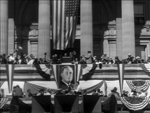 B/W 1932 long shot Franklin Roosevelt at podium at rally during campaign with people cheering clapping
