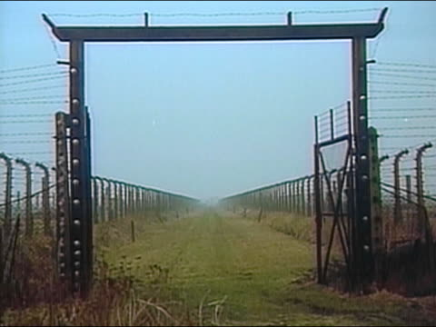 1994 long shot gate at entrance to Auschwitz concentration camp / Poland / AUDIO