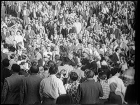 vídeos y material grabado en eventos de stock de long shot group of men leading sugar ray robinson thru crowd after boxing match / berlin - 1951