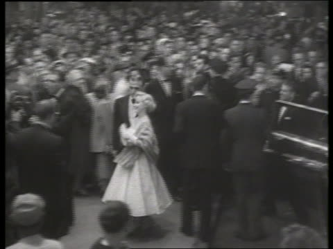 b/w 1954 long shot guests arrive at movie premiere / no sound - 1954 stock videos & royalty-free footage