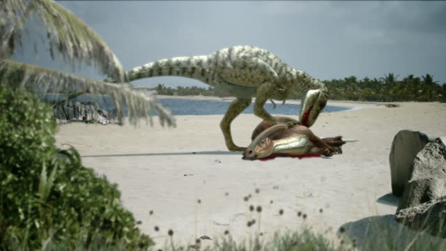 Long Shot hand-held - A dinosaur on a beach feeds on a carcass in a computer-generated animation. / Los Angeles, California, USA
