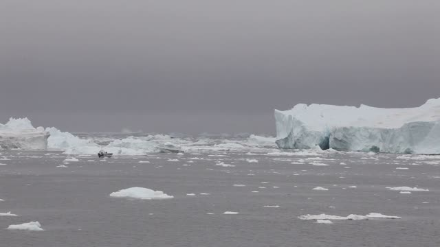 long shot, icebergs are seen in the water off the coast of ilulissat, greenland. as the sea levels around the globe rise, researchers affiliated with... - other stock videos & royalty-free footage