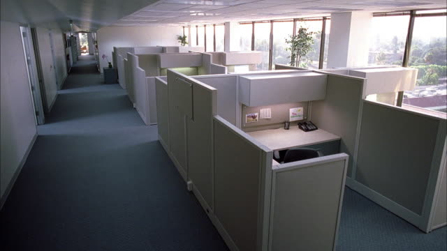 long shot int empty office aisles and cubicles - office partition stock videos & royalty-free footage