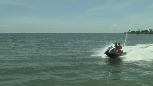 long shot jet ski ride in sokha beach cambodia - acquascooter video stock e b–roll