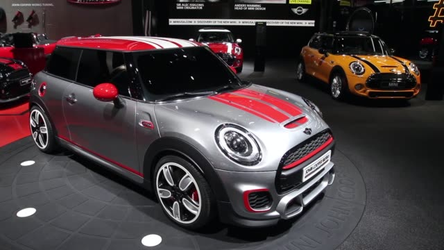 long shot john cooper works minis are displayed at the north american international auto show on january 14 2014 in detroit michigan the auto show... - 自動車ブランド mini点の映像素材/bロール