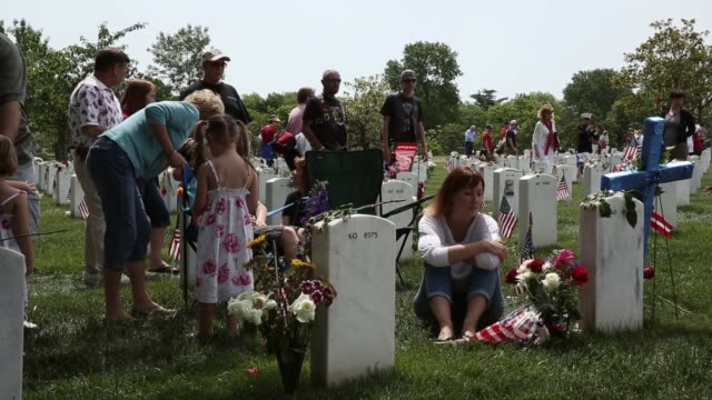 long shot kristen smith of frederick maryland visits her brother usmc sergeant david james smiths gravesite at section 60 of arlington national... - sergeant stock videos & royalty-free footage