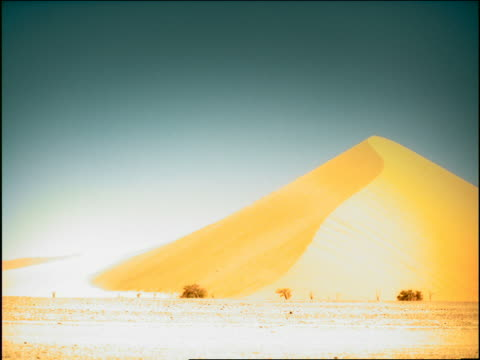 overexposed long shot large sand dune in desert / namibia, africa - overexposed stock videos & royalty-free footage