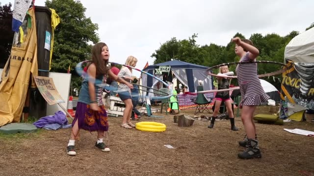 long shot, little girls playing hula hoop at the protestors' camp. protesters gather outside a drill site operated by cuadrilla resources ltd on... - west sussex stock videos & royalty-free footage