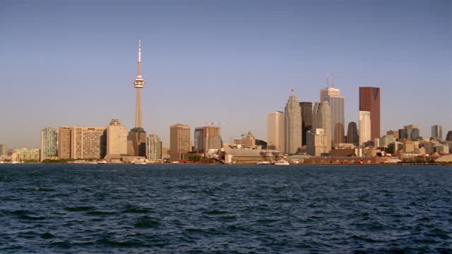 long shot looking across harbor at toronto skyline at twilight - real time stock videos & royalty-free footage