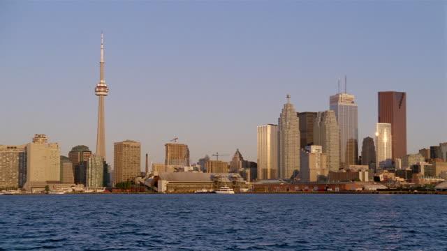 Long shot looking northeast across harbor at Toronto skyline at sunrise
