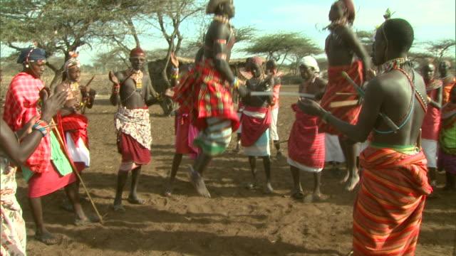 Long Shot - Maasai tribesmen perform a ritual dance / Kenya