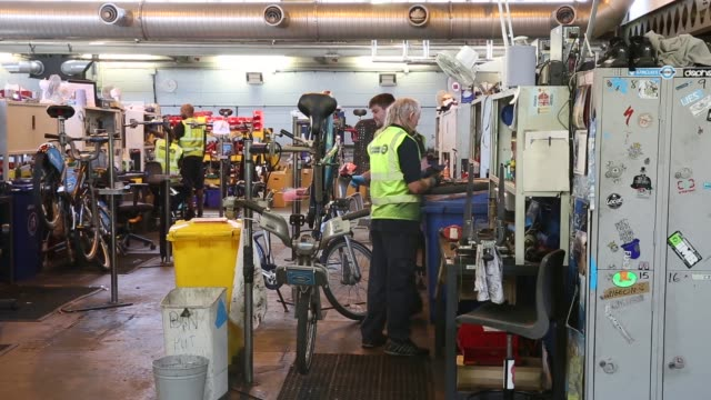 long shot, mechanics repair damaged barclays cycle hire bikes in the mechanical workshop of the cycle hire's penton street depot on september 5, 2013... - new hire stock videos & royalty-free footage