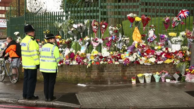 long shot members of the community lay flowers close to the scene where drummer lee rigby of the 2nd battalion the royal regiment of fusiliers was... - brutal killing stock videos & royalty-free footage