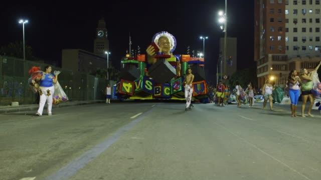 long shot members of uniao da ilha samba school get ready prior to their entrance as part of the 2014 brazilian carnival at sapucai sambadrome on... - samba school stock videos and b-roll footage