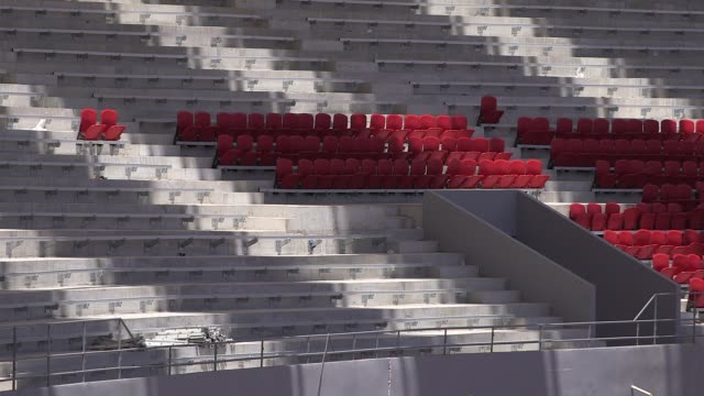 long shot newly inserted seats construction at estadio beirario in porto alegre continues home to the sport club internacional one of brazil's... - porto alegre stock-videos und b-roll-filmmaterial