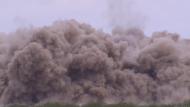 Long shot of a controlled explosion.