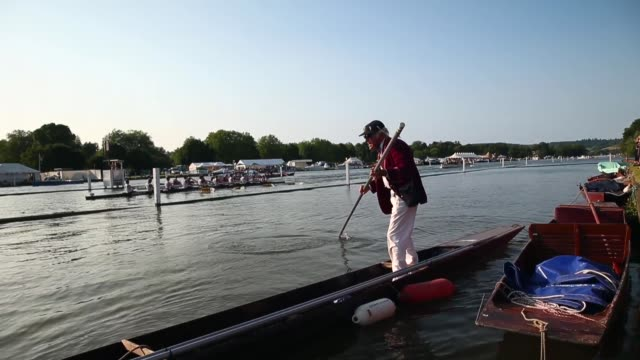long shot of a man moving across on a boat at the henley royal regatta - rowing stock videos & royalty-free footage