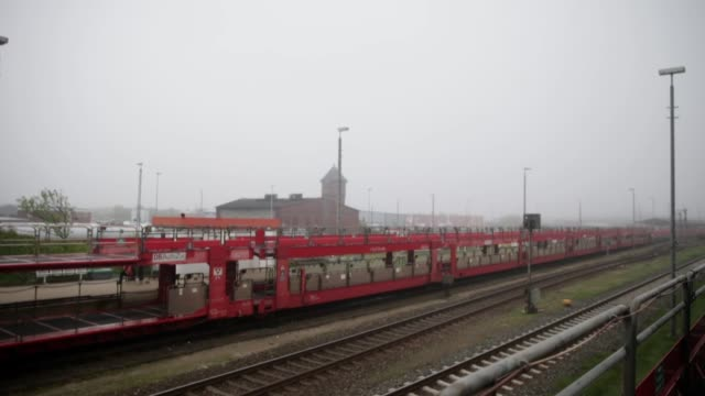long shot of a moving transportation train shot from a moving train car transport train on may 18 2013 in westerland federal republic of germany - insel sylt stock-videos und b-roll-filmmaterial
