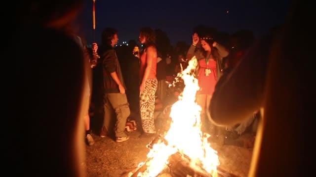 long shot of a people enjoying music at a bonfire - bonfire stock videos & royalty-free footage