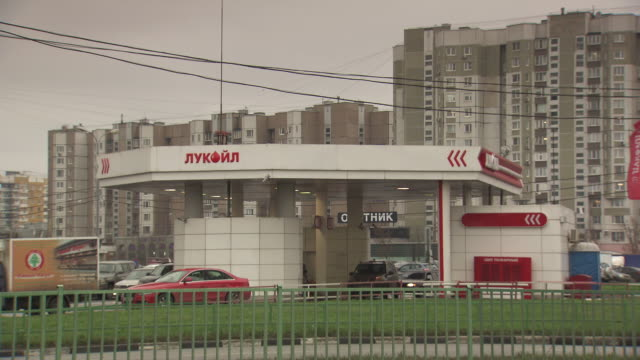 long shot of a petrol station in moscow. - fuel pump stock videos and b-roll footage