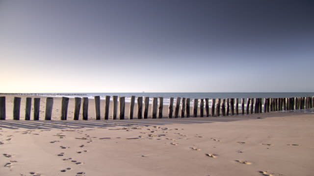 Long shot of a row of groynes on a beach near Calais, France.