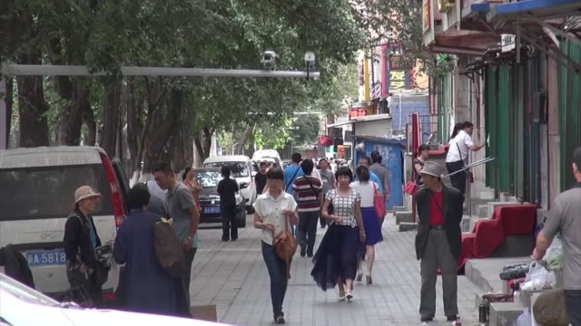 long shot of a street in urumqi where a surveillance camera is set on a pole above the street - xinjiang province stock videos & royalty-free footage