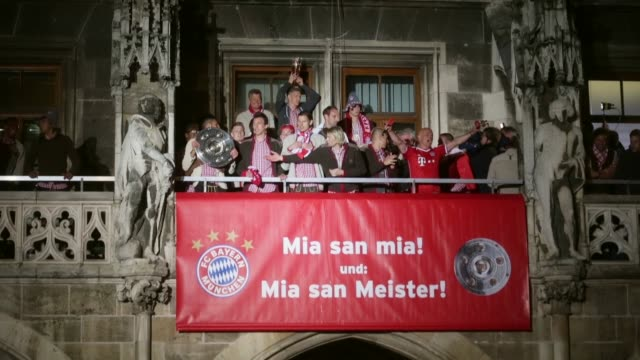 Long shot of Bayern Muenchen team as they celebrate the German championship title on the town hall balcony at Marienplatz on May 11 2013 in Munich...