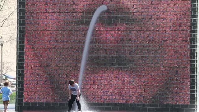 Long shot of children playing in Crown Fountain in Millennium Park Chicago Scenes From The Windy City on April 22 2013 in Chicago Illinois Long shot...