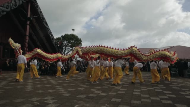 Long shot of Chinese dragon dancers performing traditional dance New Zealand Taniwha and Dragon Festival on April 27 2013 in Auckland New Zealand...