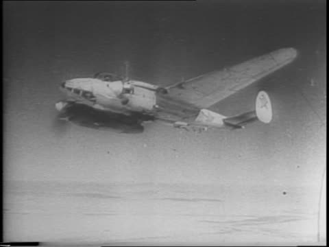 long shot of clouds over caucasus mountains / russian bombers flying over clouds / underside of soviet plane flying / soviet pilot in cockpit looks... - 1943 stock-videos und b-roll-filmmaterial