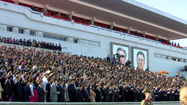 long shot of crowds watching a military parade at kim ilsung square pyongyang - parade stock videos & royalty-free footage