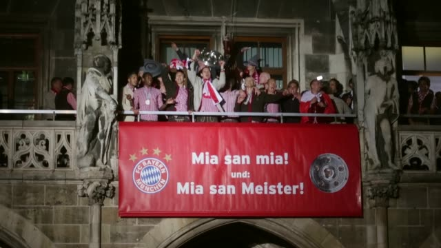 Long shot of Daniel van Buyten of Bayern Muenchen as he celebrates the German championship title lifting the trophy on the town hall balcony at...