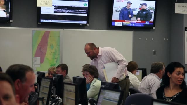 Long shot of emergency response personel Emergency response personnel participate in a hurricane response exercise at the South Florida Water...
