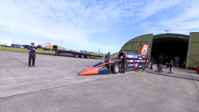 Long shot of engineers working on the Bloodhound supersonic car that hopes to break the land speed record
