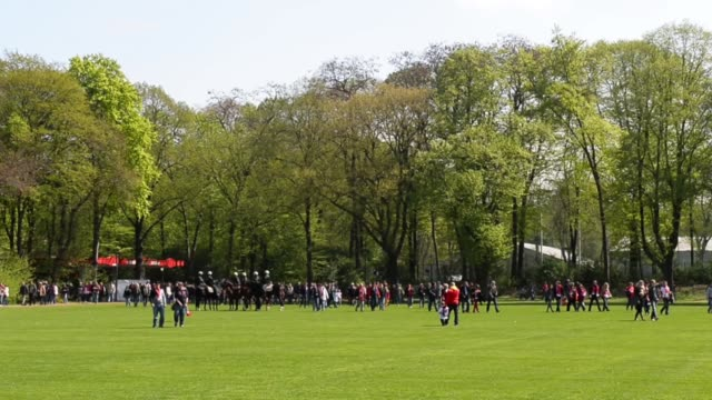 Long shot of fans walking through the park close to the stadium 1 FC Koeln v TSV 1860 Muenchen 2 Bundesliga Editorial Video Footage at...