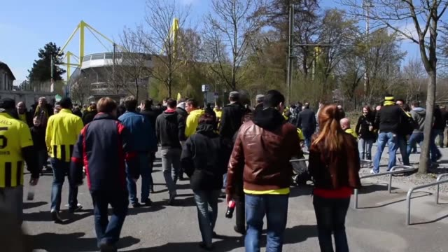 long shot of fans walking towards stadium signal iduna park general view at signal iduna park on april 20 2013 in dortmund federal republic of... - borussia dortmund stock videos and b-roll footage