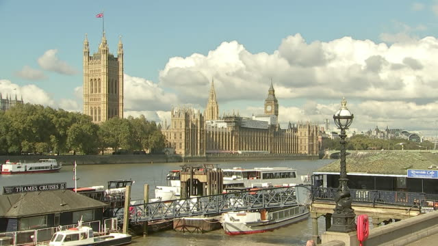 long shot of houses of parliament from across the thames river, london england - united states and (politics or government) stock videos & royalty-free footage