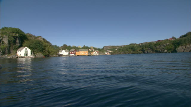 long shot of houses on the shoreline at televag.  - sunny stock videos & royalty-free footage