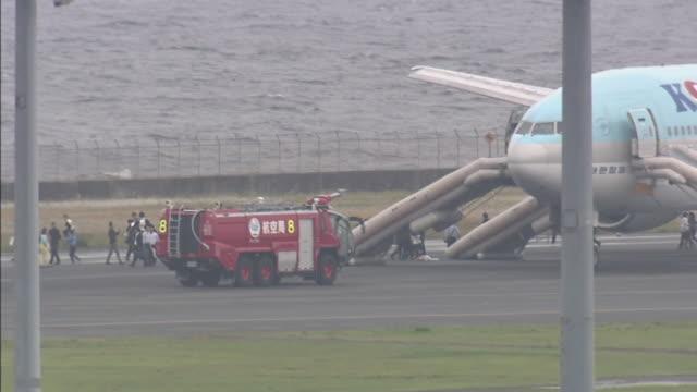 Long shot of korean air boeing 777 and japan civil aviation bureau